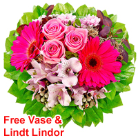 Dramatic Bouquet of Sundry Flowers in Vase and Lindt Lindor<br>